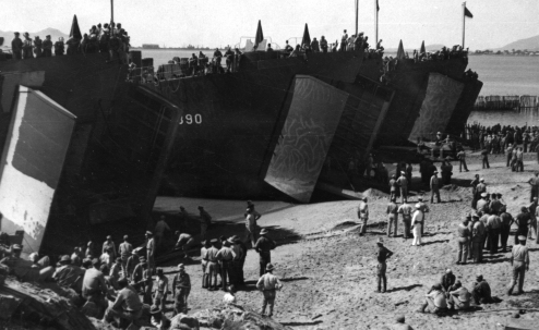 LST's unloading from a beach landing. 1943 [U.S. Navy Seabee Museum]