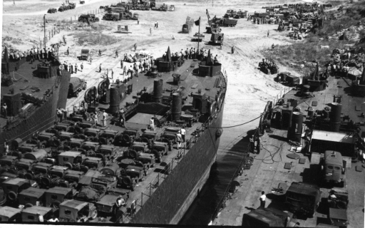 Seabees waiting to offload cargo from the top deck of the LST. 1943 [U.S. Navy Seabee Museum]
