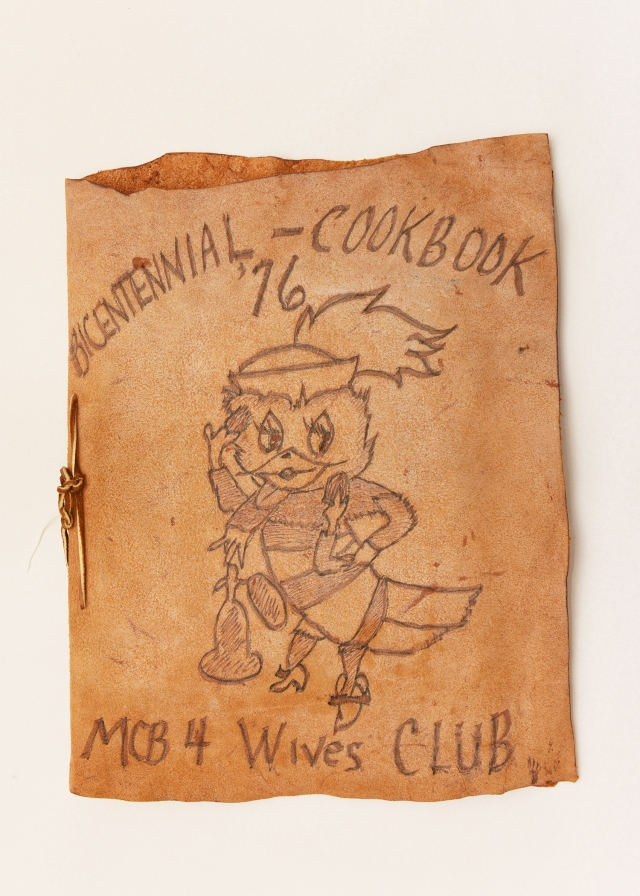Cookbook, created by the NMCB 4 wives club with Phoebe on the cover. 1976 (U.S. Navy Museum Collection)