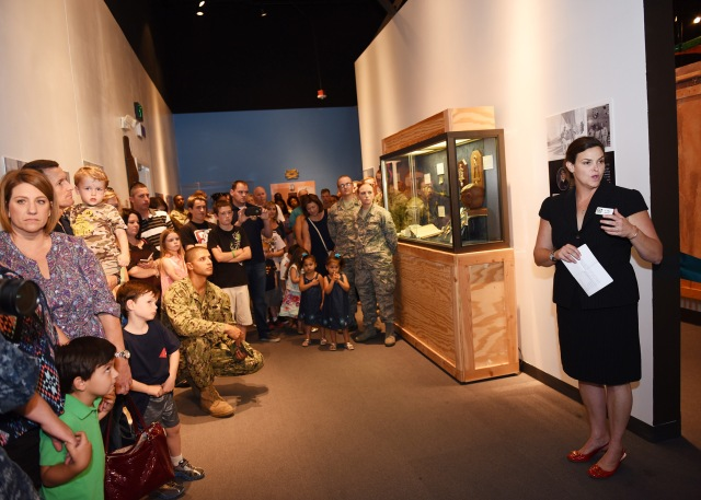 150606-N-JU810-014 PORT HUENEME, Calif. (June 6, 2015) U.S. Navy Seabee Museum Director Dr. Lara Godbille welcomes visitors to the ribbon-cutting ceremony celebrating the opening of the Science, Technology, Engineering and Math (STEM) Center at the U.S. Navy Seabee Museum. U.S. Air Force Tech Sgt. William Powell and his wife Jessica donated the funds to build the center in memory of their daughter, Kennedy, who died in January 2014 from a rare illness when she was 15 months old. The exhibit will be the center of youth educational programming for the museum by tying in the educational tenets of STEM with the history and fundamentals of the Seabee job ratings. (Photo by Aramis X. Ramirez, Public Affairs Officer, U.S. Navy Seabee Museum/RELEASED)