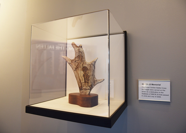 Fallen Soldier Battle Cross and eagle hand carved onto an antler as a dedication to the Seabees of NMCB 25 that passed away in 2006. This was donated to the U.S. Navy Seabee Museum and currently on exhibit in the Hall of Heroes.
