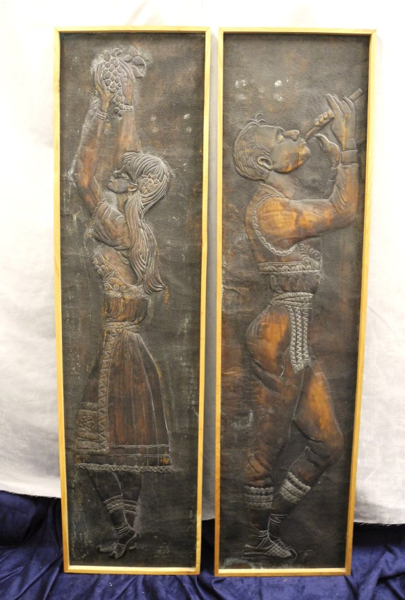 Yugoslavian art reliefs of man and woman