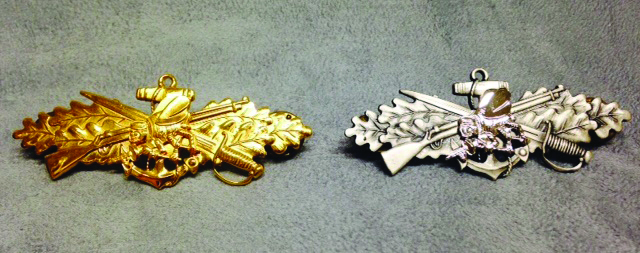 Seabee Combat Warfare Specialist Insignias; the gold insignia is worn by an officer and the silver is worn by enlisted Seabee (U.S. Navy Seabee Museum)