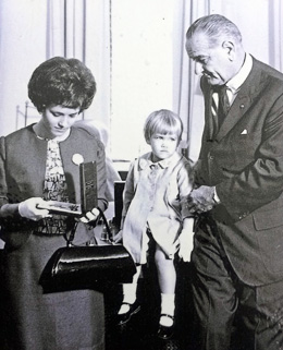 Shield's widow and daughter receive his Medal of Honor from President Johnson