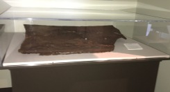 A by a piece of the superstructure of the U.S.S. Arizona.