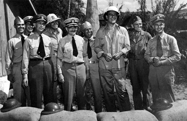 Combs on the set of The Fighting Seabees, Camp Pendleton, Calif., with actor John Wayne, 1943.