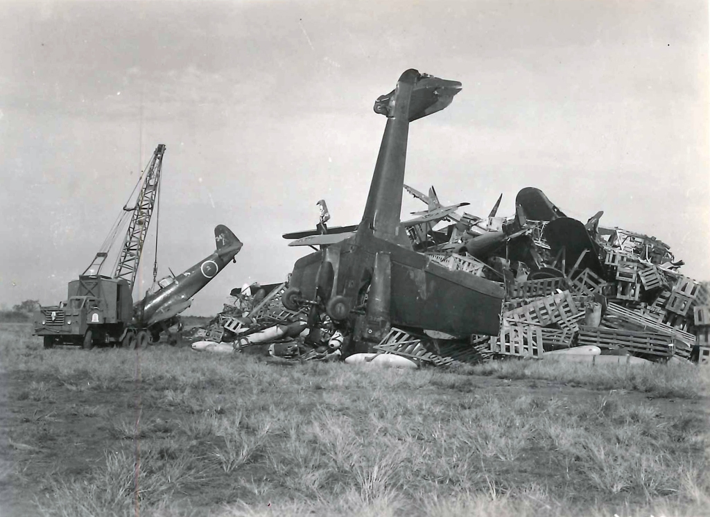 Seabees with the 31st NCB piling Japanese aircraft for destruction, Omora, Japan, in January 1946.