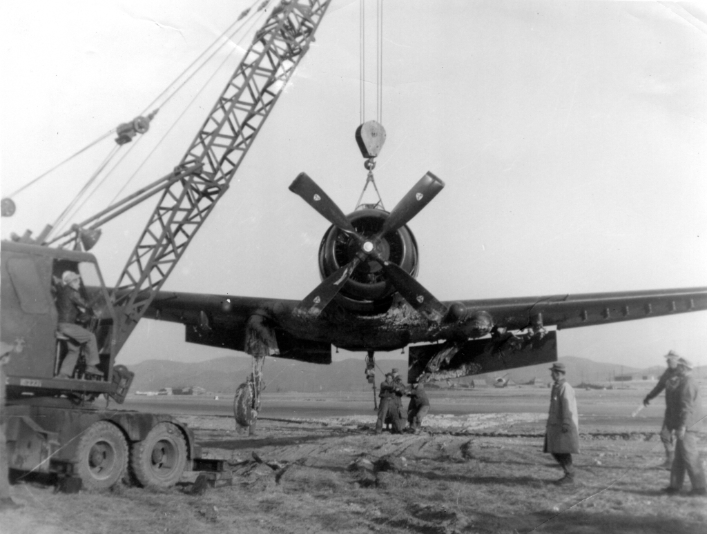 Seabees help recover damaged aircraft, fall 1950.