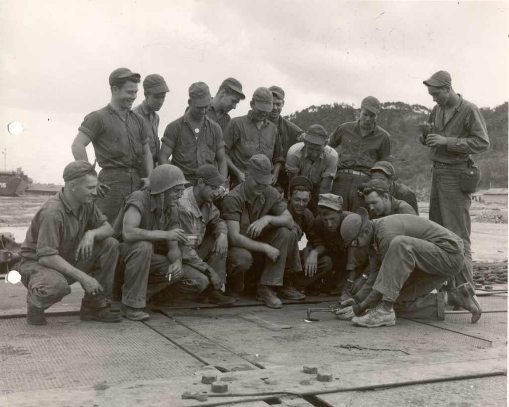 Seabees deployed with ACB-1 working on pontoon causeways, circa fall 1950.