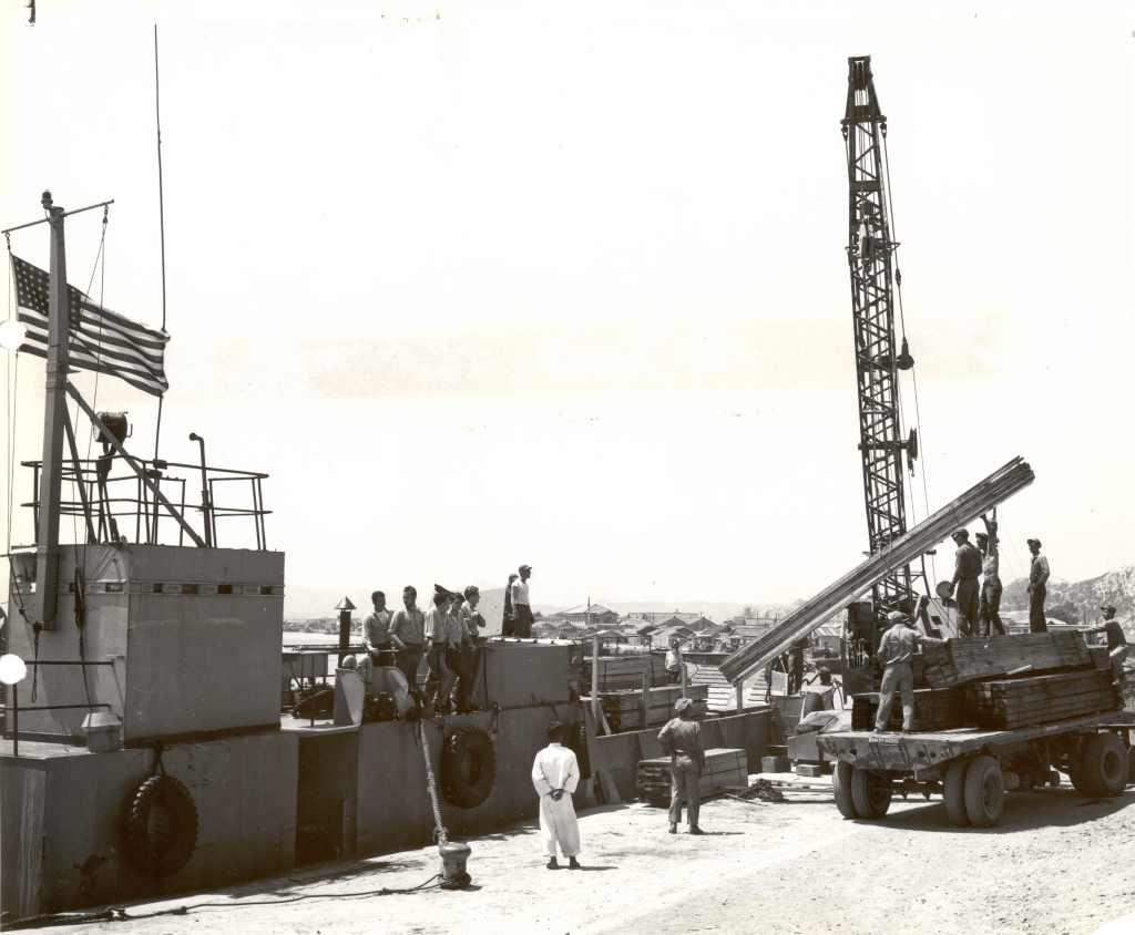CBD 1804 offloading supplies in Pohang Harbor, circa fall 1950.